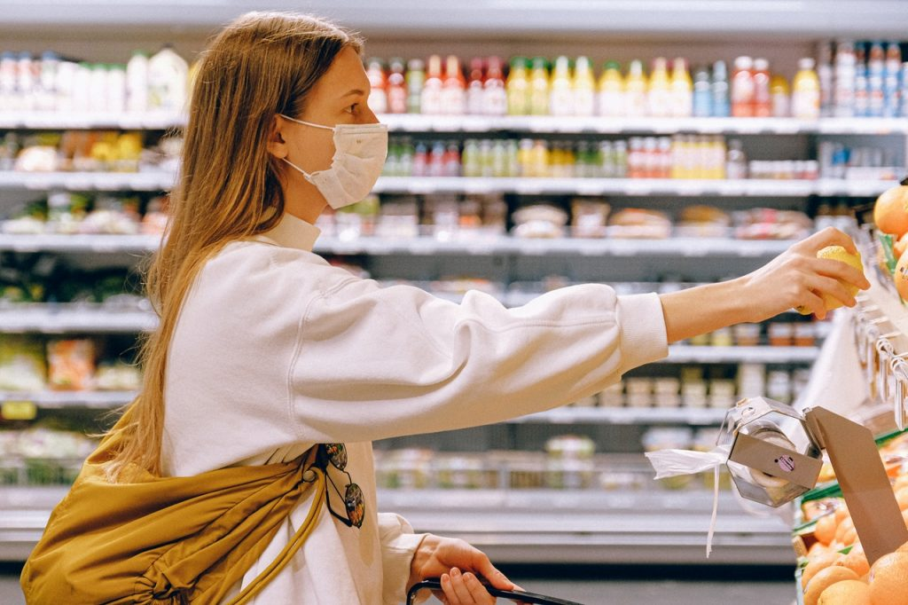 This image has an empty alt attribute; its file name is woman-wearing-mask-in-supermarket-3962289-1024x682.jpg